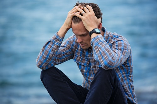 A man looks anxious, cognitive behavioral therapy might help him